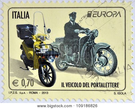 ITALY - CIRCA 2013: Stamp printed in Italy shows a Moto Guzzi Galletto from 1962 and a modern Piaggi