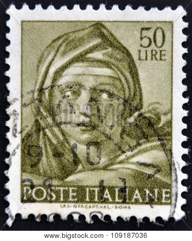 ITALY - CIRCA 1961: A stamp printed in Italy shows Designs from Sistine Chapel by Michelangelo Delph