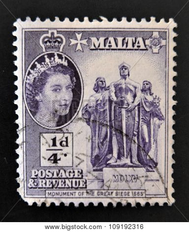 MALTA - CIRCA 1956: A stamp printed in Malta shows monument of the great siege circa 1956