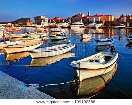 Pier with boats and yachts near the old town. Montenegro coast poster