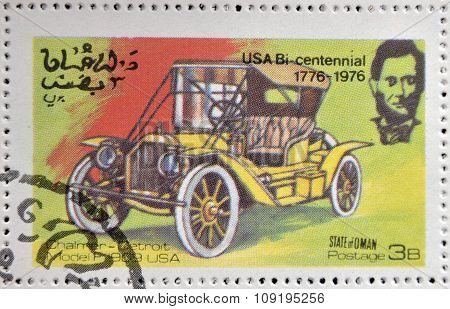 OMAN - CIRCA 1976: A stamp printed in State of Oman shows a american car chalmer detroit model P 190
