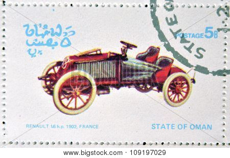 OMAN - CIRCA 1977: A stamp printed in State of Oman shows a old car Renault 16 hp 1902 France