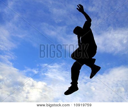 Silhouette Of Man Jumping In the sky