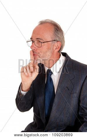 Businessman Giving Sign With Finger Over Mouth.