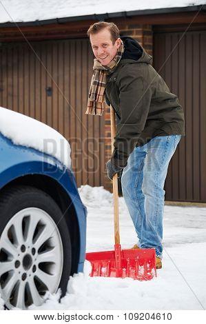 Motorist Digging Car Out Of Snow