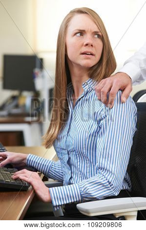 Businessman Sexually Harassing Female Colleague