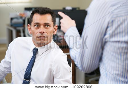 Businessman Being Shouted At By Female Colleague