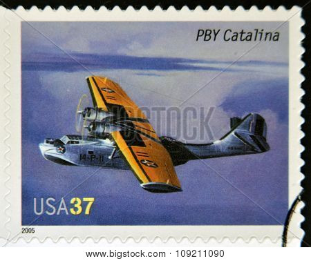 A stamp printed in USA dedicated to advances in aviation shows Consolidated PBY Catalina