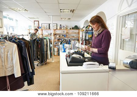 Volunteer Working In Charity Shop