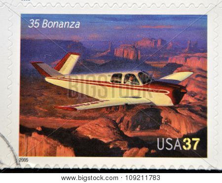 A stamp printed in USA dedicated to advances in aviation shows Beechcraft 35 Bonanza