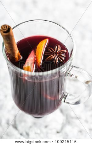 Glass Of Mulled Wine In Snow
