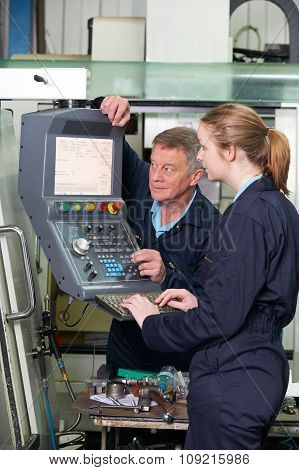 Engineer And Apprentice Using Computerized Cutting Machine