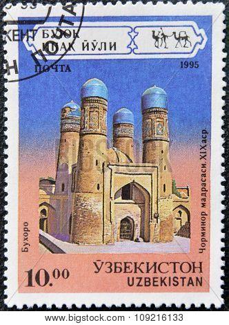 A stamp printed in Uzbekistan shows Tchar-Minor Madrasa Bukhara XIX century circa 1995