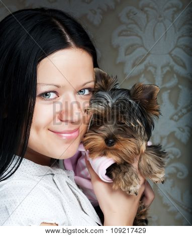 young girl with her Yorkie puppy