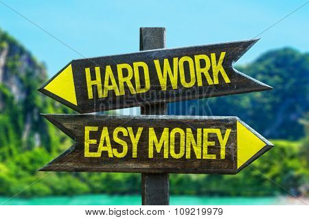 Hard Work - Easy Money signpost in a beach background