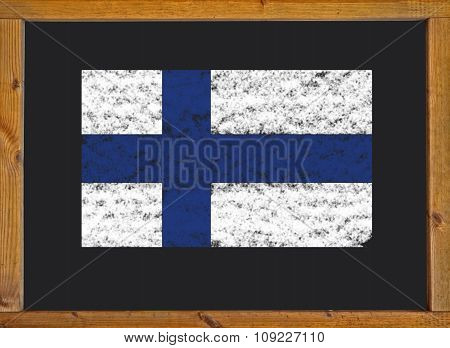 Finland flag on a blackboard