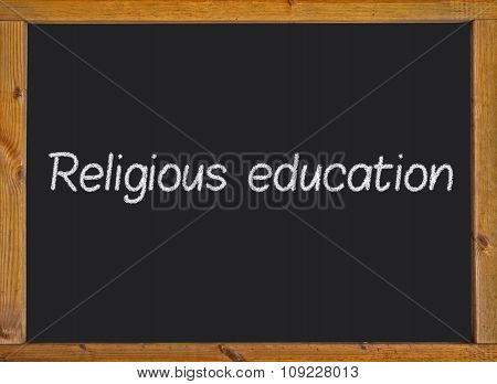 Religious education written on a blackboard