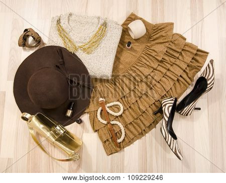 Winter Sweater And Leather Skirt With Accessories Arranged On The Floor.