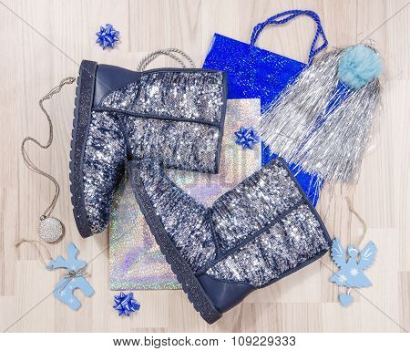 Winter Christmas Sparkly Boots With Accessories Arranged On The Floor.