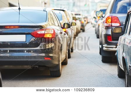 Urban traffic jam with rows of cars in a city street road during rush hour