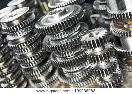 metalwork industry. close-up metal cog wheels gears at factory