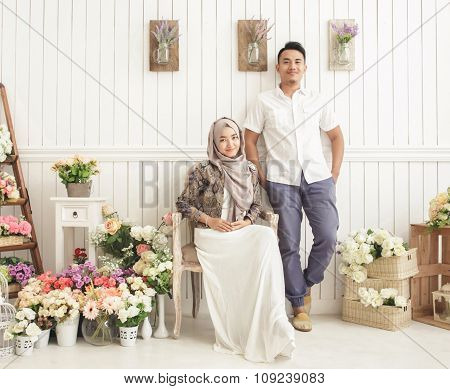 Married Couple At Decorated Room