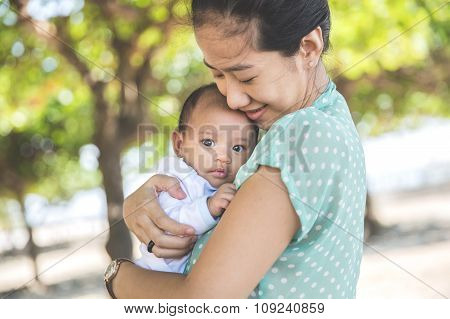 Woman Holding Her Baby Girl