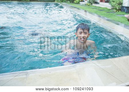A Boy Playing On The Pool, Close Up