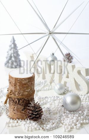 Pure christmas decoration with candle, pineal and letters xmas.