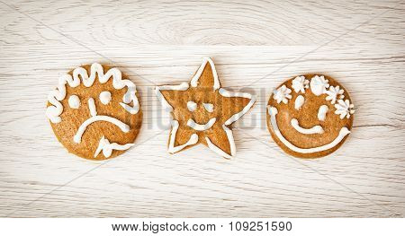 Three Tasty Gingerbread Smiley Faces, Christmas Symbol