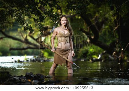 wild amazonian hunter hunting in a river
