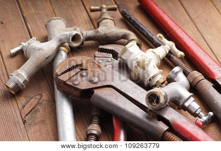 plumbing tools lying with old pipes and faucets poster