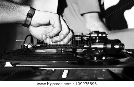 DJ turntable playing. DJ playing the music