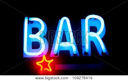 Blue neon bar sign. Advertising neon sign glow in dark