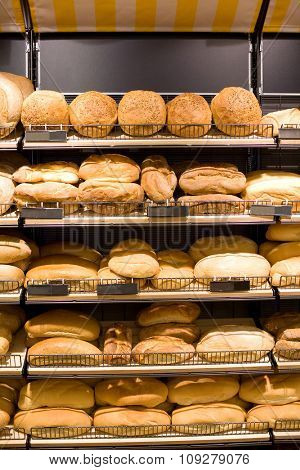 Bakery Store shelves full of various bread.