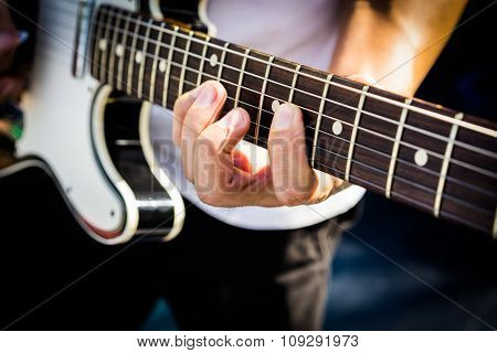 Hand Of The Guitarist On Electric Guitar Fingerboard
