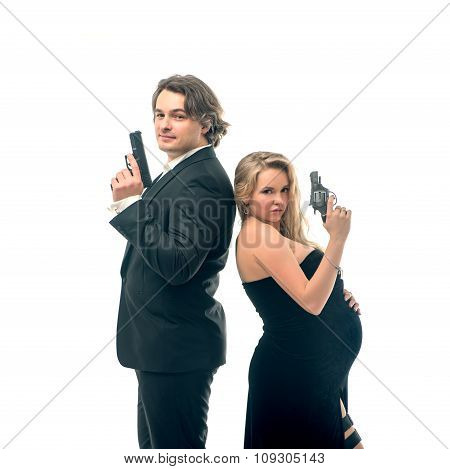 Pregnant fashion woman and husband in gangsta style