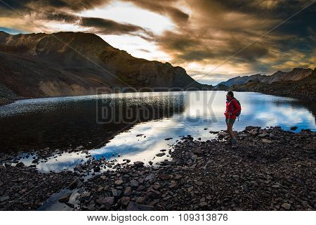 Hiker Near Crystal Lake At Sunset Ophir Pass Colorado