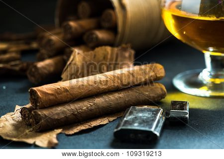 Cuban Cigars On Tobacco Leafs