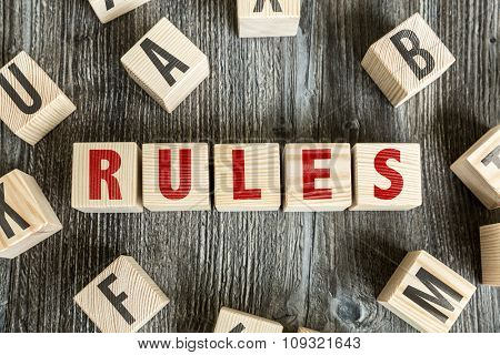 Wooden Blocks with the text: Rules
