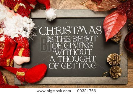 Blackboard with the text: Christmas is the Spirit of Giving Without a Thought of Getting