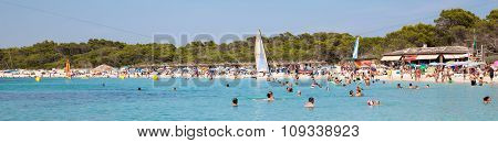 People In Es Trenc Beach With White Sand And Turquoise Sea
