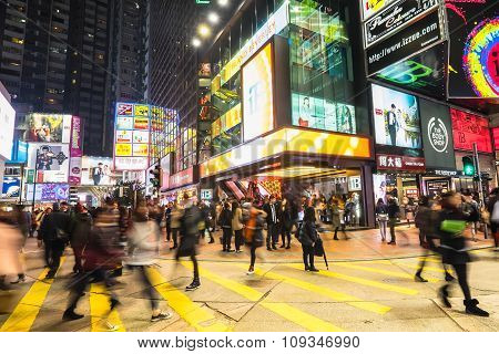 Hong Kong - Jan 16, 2015: Night View Of Big Sopping Mall With Bright Illuminated Banners And People