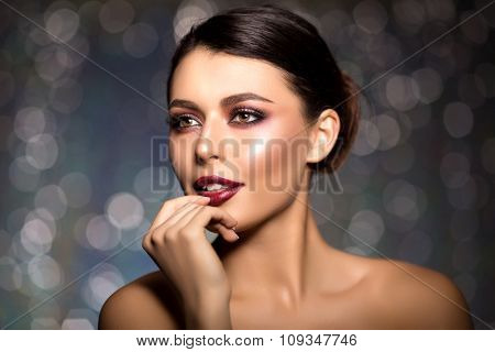 Beautiful model woman in beauty salon makeup Young modern girl in luxurious spa Lady make up Mascara for long lashes lipstick on lips eye shadow shiny hair manicure with nail polish Products Treatment poster