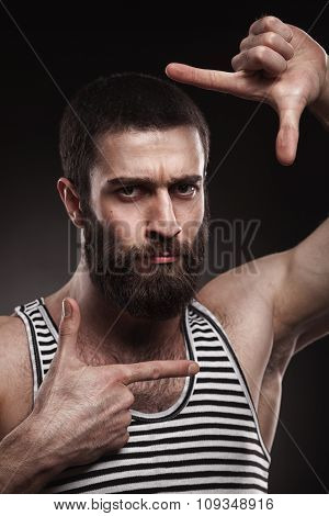 portrait of beardy man in singlet