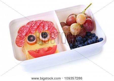 Lunchbox with creative sandwich and fruits isolated on white background