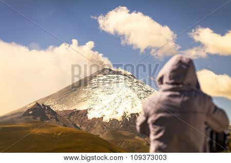 Professional photographer posing a powerful volcano explosion