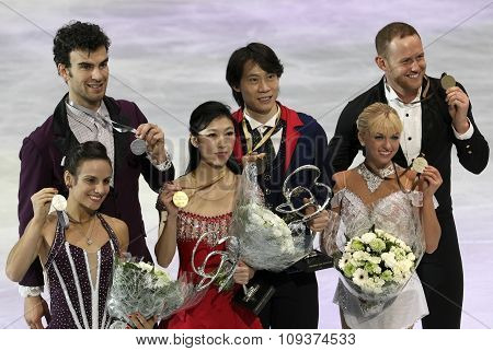 Pairs With Medals At The Victory Ceremony