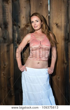 Redhead In A White Skirt