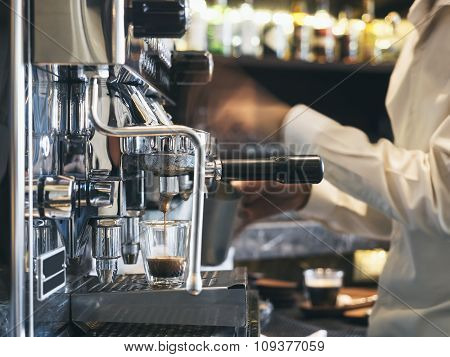 Coffee Shop with Barista Making espresso shot in Restaurant